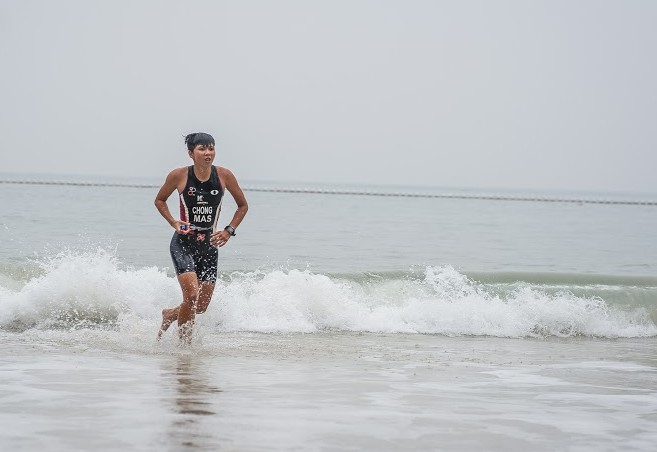 Malaysia's National Triathlete Irene Chong, out of the water and into the trails.