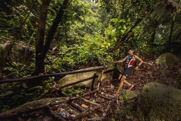 Malaysia's National Triathlete, Irene Chong running the jungle trails.