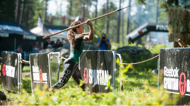 Rose Wetzel at the spear throw. Image from Reebok Fitness
