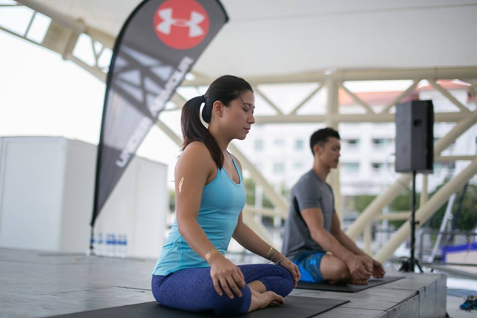 Sunset Flow Yoga session conducted by Hansen Lee and Robyn Lau at Straits Quay, Penang.