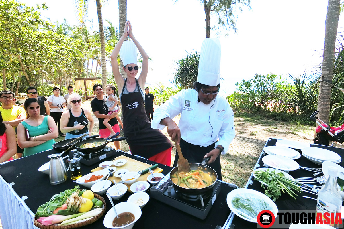 Tara Stiles brings yoga to the kitchen in a tree pose as Chef Ann cooks on.