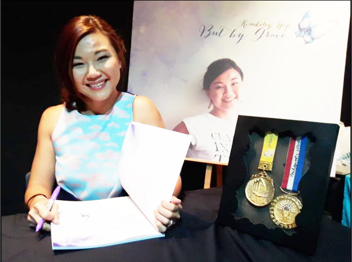 Kimbeley alongside her gold medals from the SEA Games. (Runwitme)