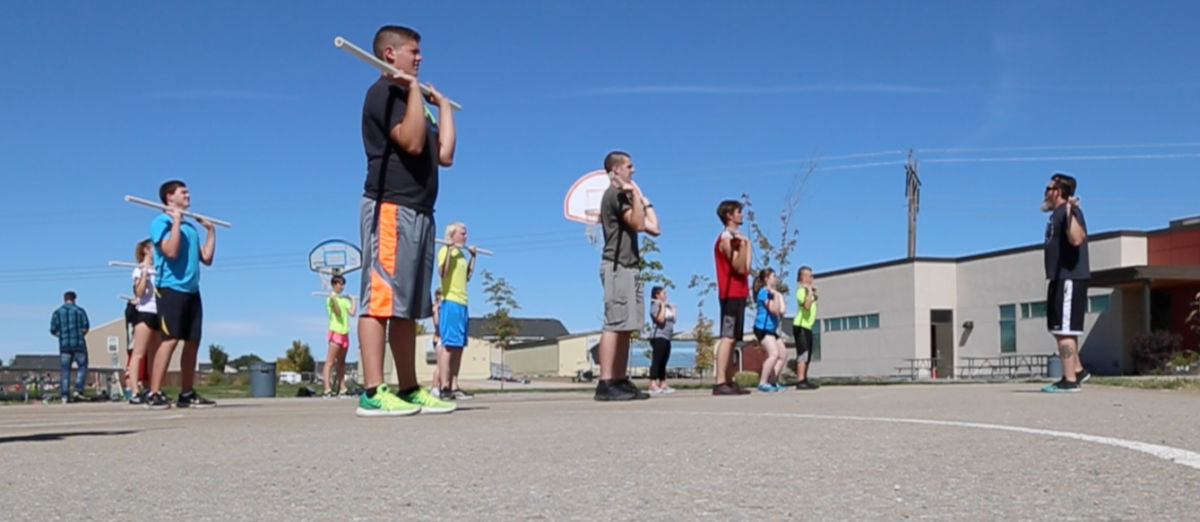 School teacher Jason George shared his passion for CrossFit in physical ed class. (IdEdNews)