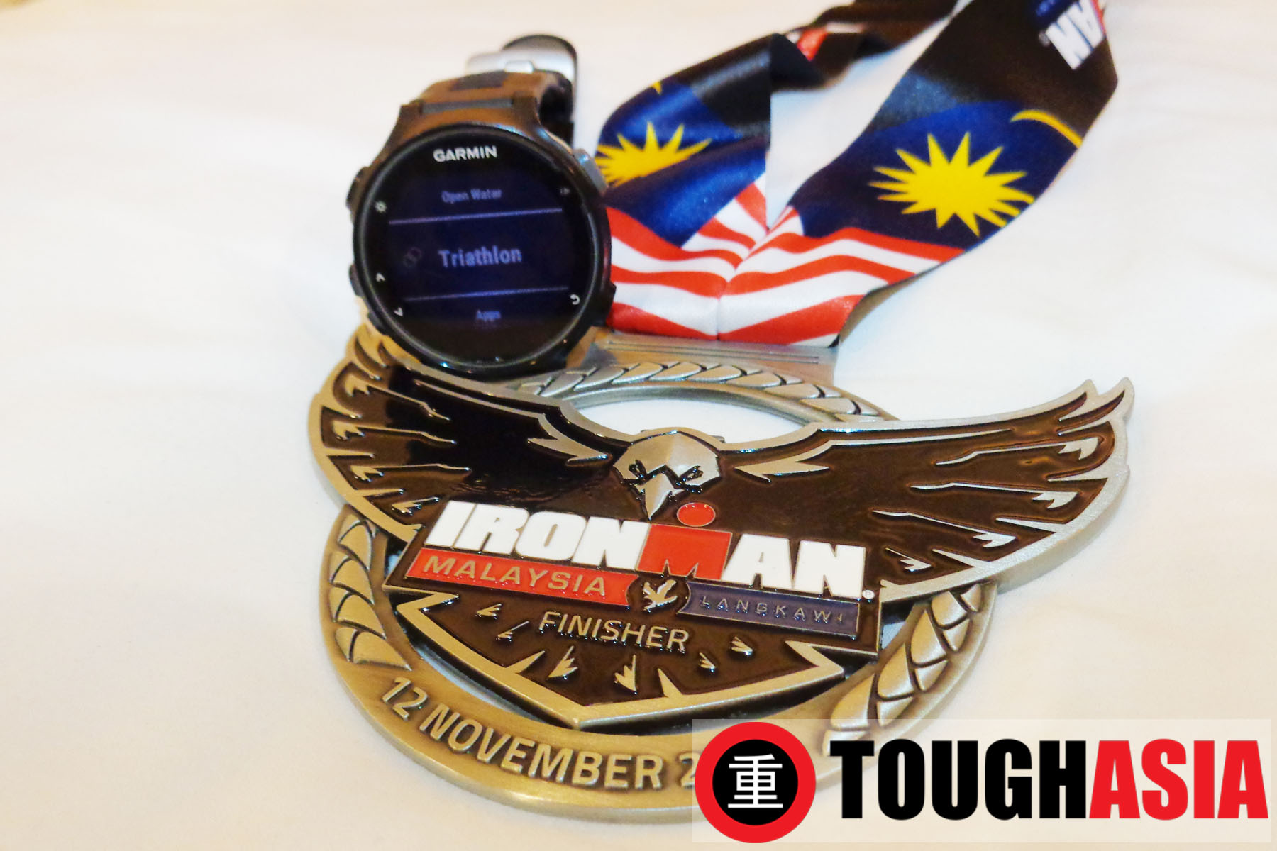 Highly coveted and hard earned maide Ironman Malaysia medal for Richard Lee alongside his loyal training buddy, Garmin Forerunner 735XT.