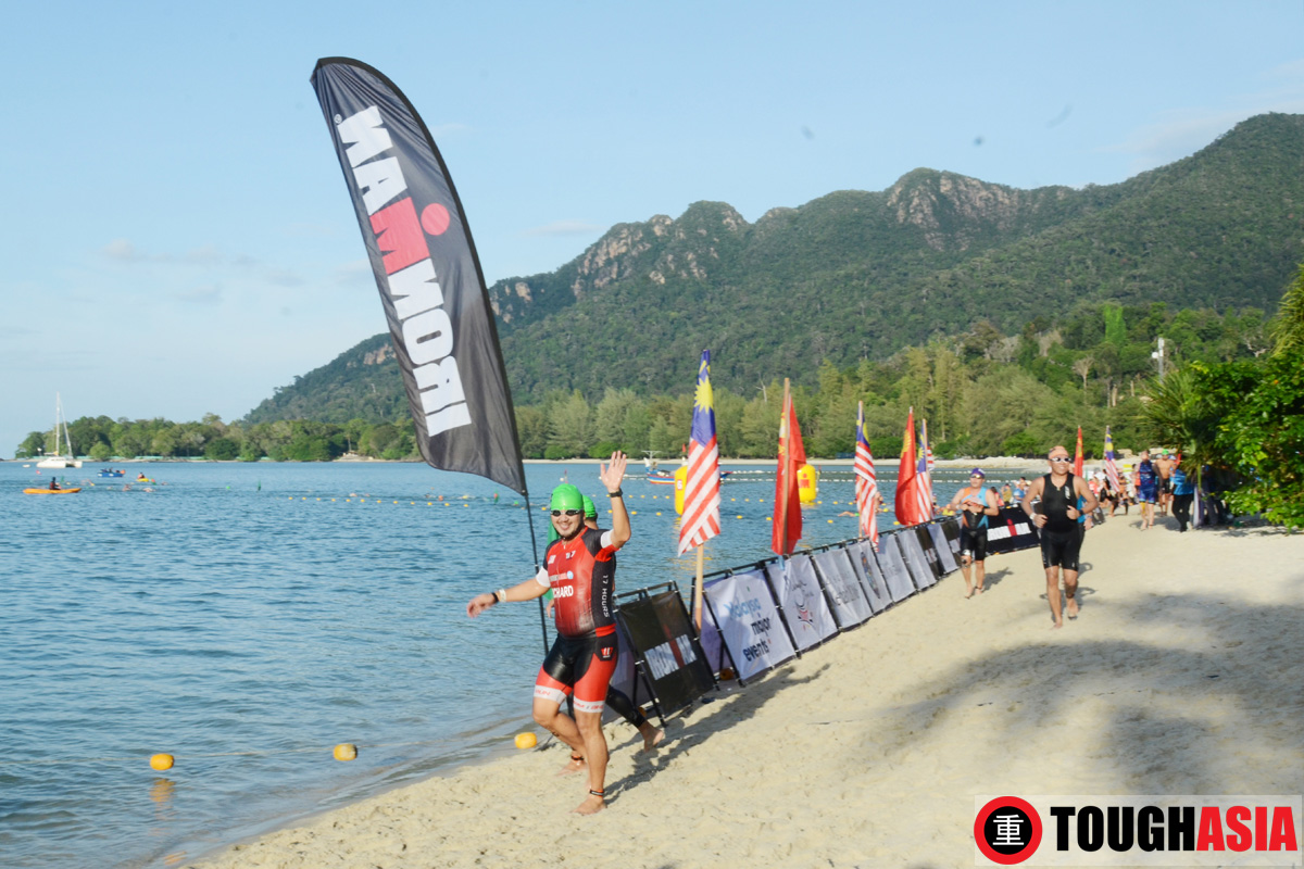 Richard Lee finishing loop one and onto completing the 3.8km swim at Pantai Kok.
