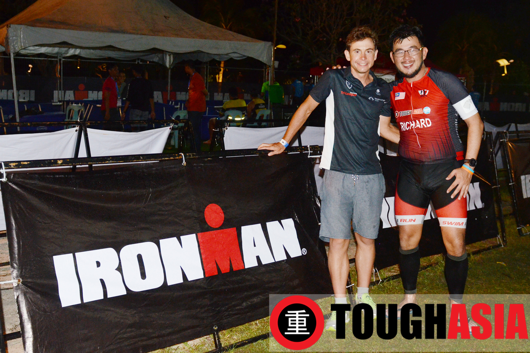 Richard Lee had the honour of receiving his finisher's medal from Ironman Malaysia Champion, Fredrik Croneborg (left).